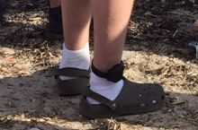 The holy trinity, socks, Crocs, and ankle monitor.